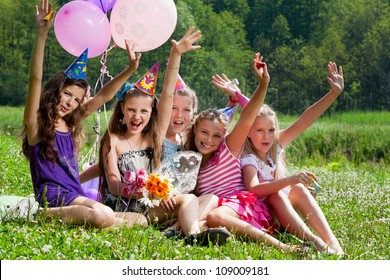 beautiful girls celebrate birthday in summer park outdoors