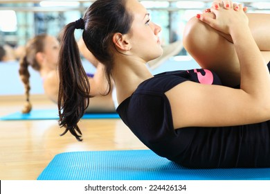 Beautiful girls doing situp workout training in the gym