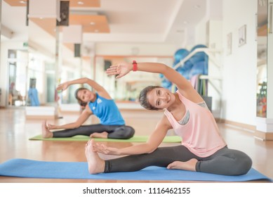 Beautiful girls are exercising in the gym.