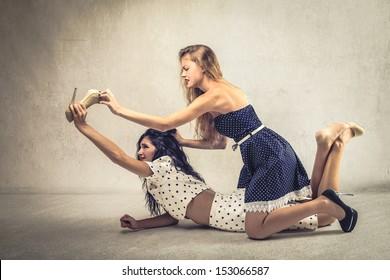 beautiful girls fighting tearing shoes