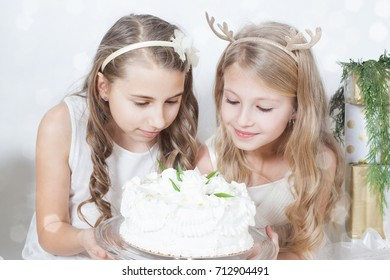 beautiful girls holding a cake among gifts  concept