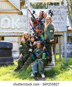 Beautiful girls in military uniform with paintball guns