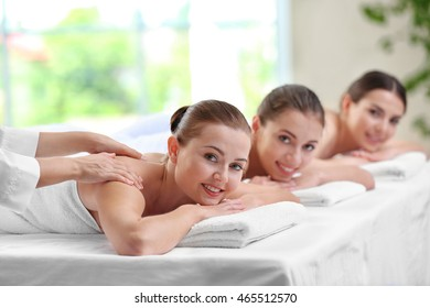 Beautiful girls relaxing in spa salon