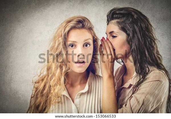 beautiful girls sharing secrets
