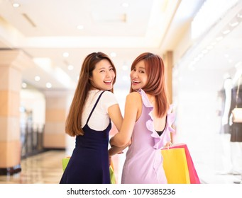 Beautiful girls shopping in the mall