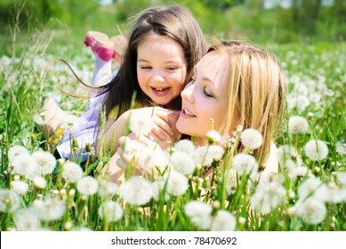 Beautiful girls in a summer meadow