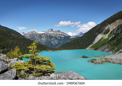A beautiful glacial lake in Canada. The turquoise Joffre Lake is surrounded by the Rainforest. Mountain peaks in the background. Joffre Lakes Provincial Park. British Columbia, Canada.