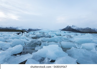 Beautiful glacial lake full of blue icebergs in the south Iceland