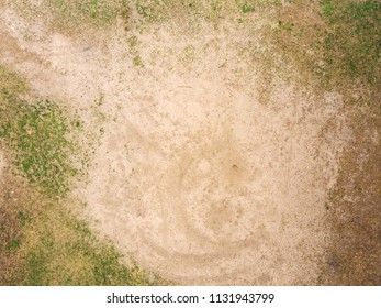 Beautiful Glade with sand and grass - top view
