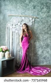 Beautiful Glamorous Fashion Model Woman in Velvel Purple Dress