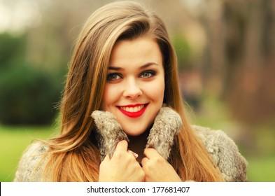 Beautiful glamorous lady having fun outdoor on gloomy winter day.