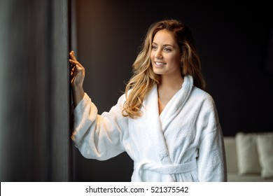 Beautiful glamorous woman in bathrobe enjoying wellness weekend