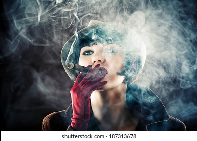 beautiful glamorous woman in retro style with cigar smoke clubs