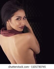 Beautiful glamorous woman turning head back,