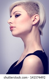 A beautiful and glamorous young woman with creative hair style. Colored and natural retouched.