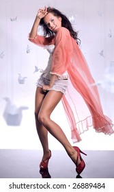 Beautiful glamour girl with a long voile
