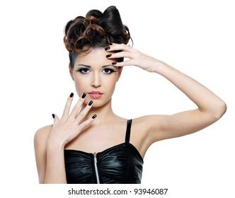 Beautiful glamour woman with stylish hairstyle and black nails. Fashion eye make-up