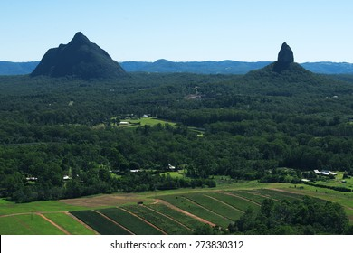 The beautiful Glass House Mountains National park during the day looking down over the mountains and range.