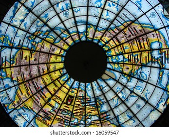Beautiful glass stained-glass window in the form of the globe, bright, colourful, with figure of a planet the ground