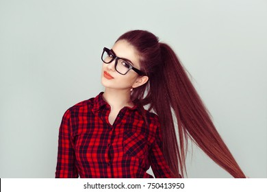Beautiful with glasses. closeup portrait, confident successful attractive young woman, fashion girl posing hand on pulling hair isolated light green background wall. Positive emotion facial expression
