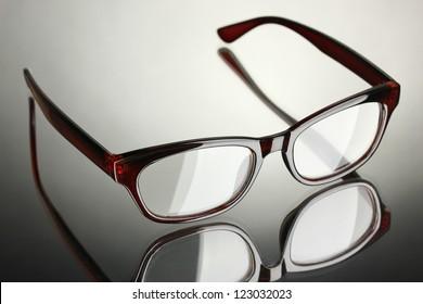 Beautiful glasses on grey background
