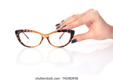 Beautiful glasses whit female hand on white background, perfect reflection