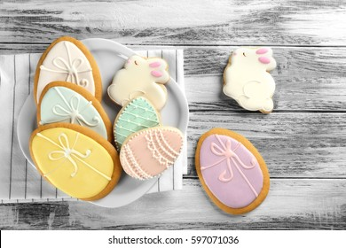 Beautiful glazed Easter cookies on wooden table