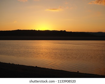 Beautiful glow from the sun setting behind Cumbrian hills across the Kent Estuary from Arnside