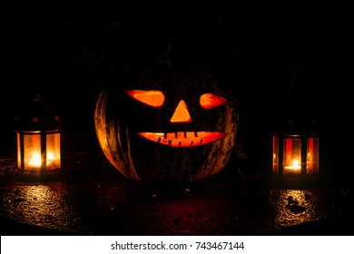 beautiful glowing pumpkin and lanterns on a close-up of halloween