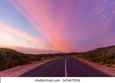 Beautiful glowing sunset ver scenic coastal road in Australia