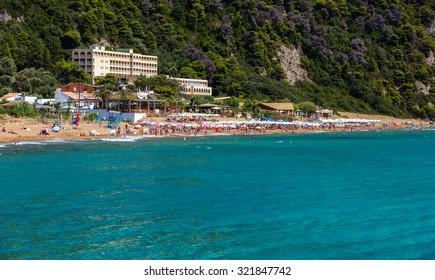Beautiful Glyfada beach on Corfu, tourists enjoying a nice summer day at the beach, Greece.