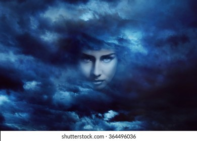 Beautiful goddess face in dramatic cloudscape . Fantasy and surreal manipulation