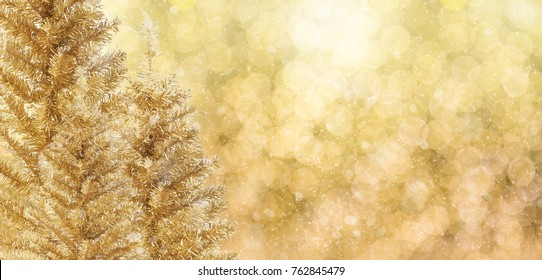 Beautiful Gold christmas tree with chrismas bokeh background