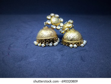 Beautiful gold earrings-Indian style-jhumka-traditional-pearls and mirror work