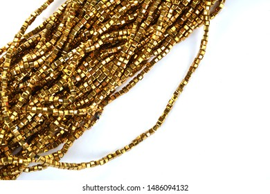 Beautiful Gold Glass Sparkle Crystal Isoalted Beads on white background
