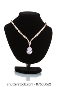 beautiful gold necklace with jewels stones on mannequin isolated on white
