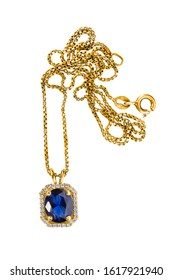 Beautiful gold necklace with sapphire pendant and diamonds isolated over white