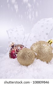 beautiful gold and red christmas decoration on white snow sparkle