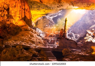 Beautiful gold sunlight shining to Sung Sot Cave or Surprise Grotto on Bo Hon Island is one of finest and widest grottoes of Ha Long Bay, situated in the center of UNESCO-declared World Heritage area