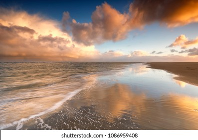 beautiful gold sunrise on North sea coast, Texel island, Netherlands