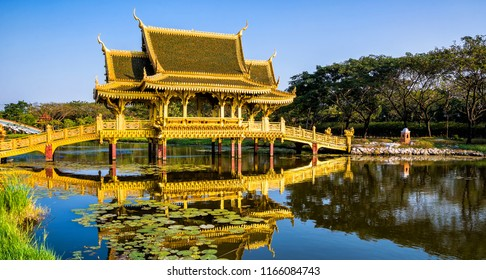 Beautiful Golden Bridge and Pavilion of the Enlightened with reflection in the water. Location: Ancient City Park, Muang Boran, Samut Prakan province,  Bangkok, Thailand. Beauty world