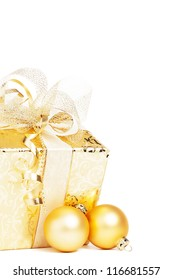 beautiful golden christmas present with golden christmas balls on white background