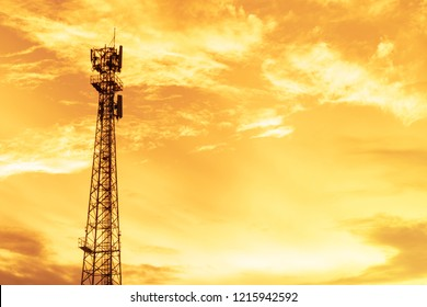 the beautiful golden color sky and antenna pole during sunset