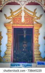 Beautiful golden craved angels in Thai's style church entrance door. Selective focus