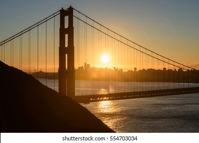Beautiful Golden Gate the entrance to San Francisco, California, USA. Sunrise scene and down town as a background.