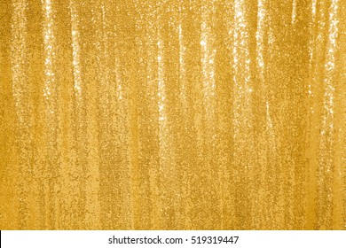Beautiful golden glitter background. Texture. Holiday background with golden sequins, copyspace, Curtain Show. Sparkling sequined textile
