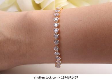 Beautiful golden heart shape bracelet with diamonds.