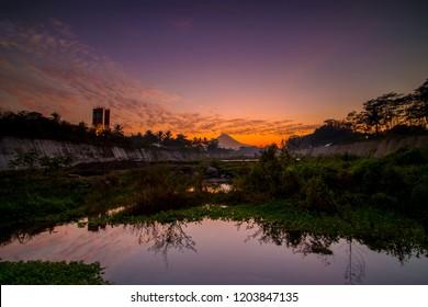 Beautiful golden hour at kali putih river. During merapi volcano eruption, many rock and lava material go through this river. kali putih river is located in muntilan, magelang, central java, indonesia