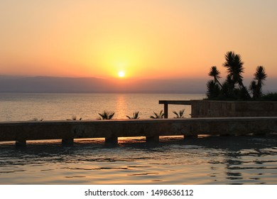 A beautiful golden hour sunset over the Dead Sea in Ishtar, Jordan, bordering Israel and the West Bank. At 434m below sea level the Dead Sea is the lowest point on earth and is a hypersaline lake.
