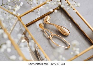 Beautiful golden jewelry on grey background